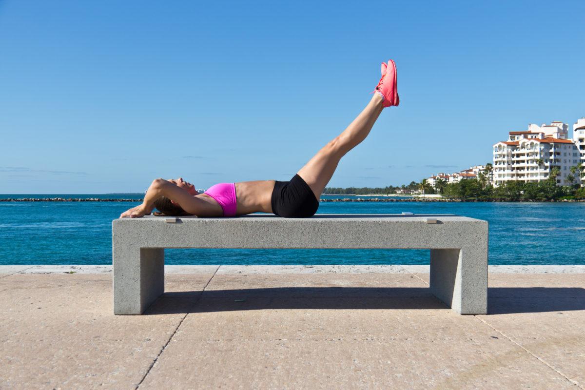 Hispanic girl doing leg raies for fitness