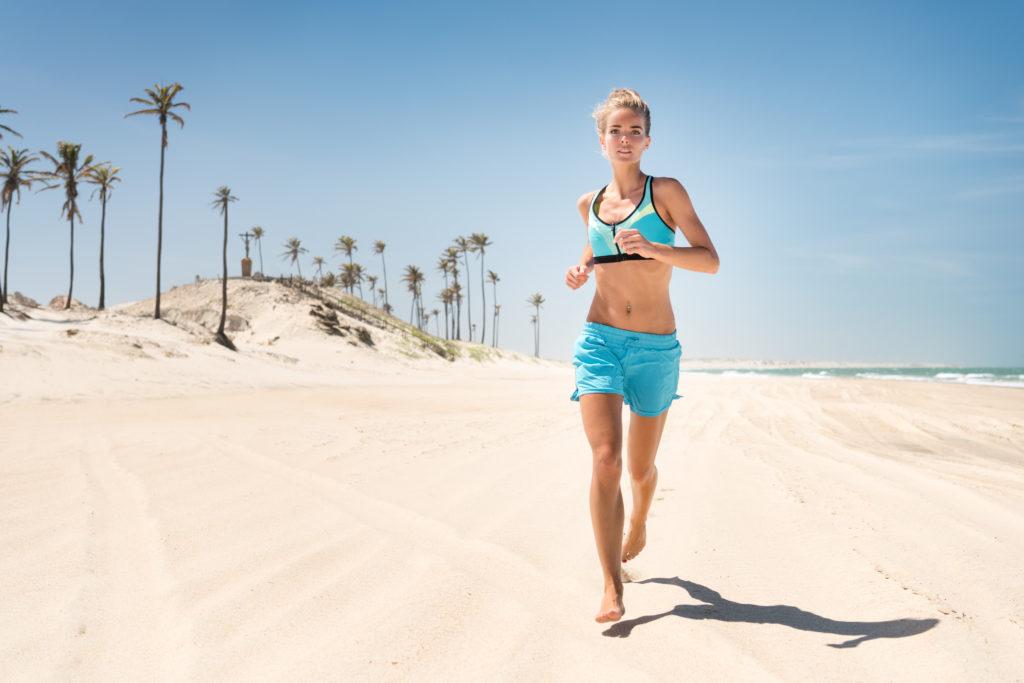 Woman running down the Beach