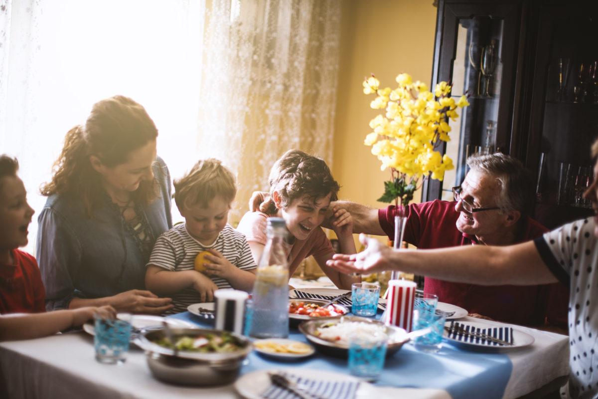 Multi-generation family enjoying lunch